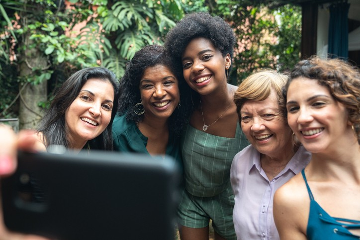 Group of Black and White women taking selfie