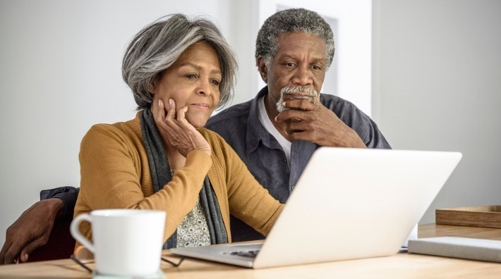 couple looking at laptop computer screen